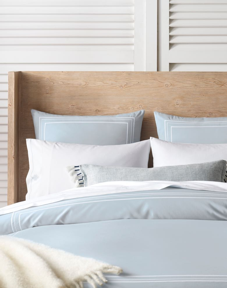 Sky Blue and White Bedding with Natural Bed