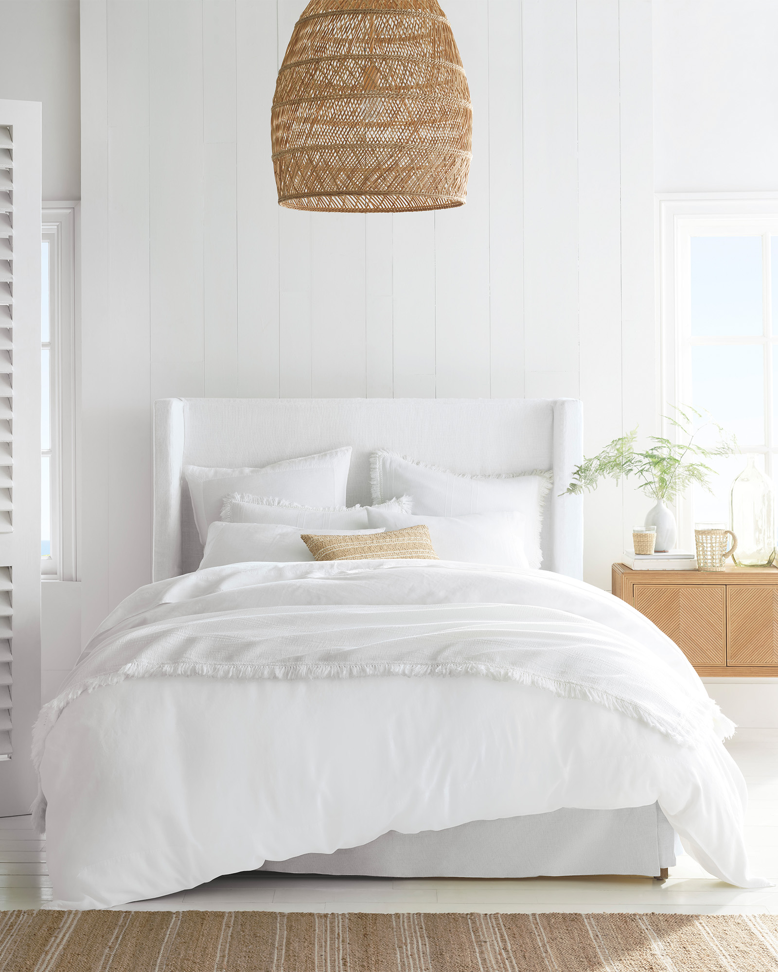 Whtie on white decor in a bedroom with rattan pendant light - Serena & Lily.