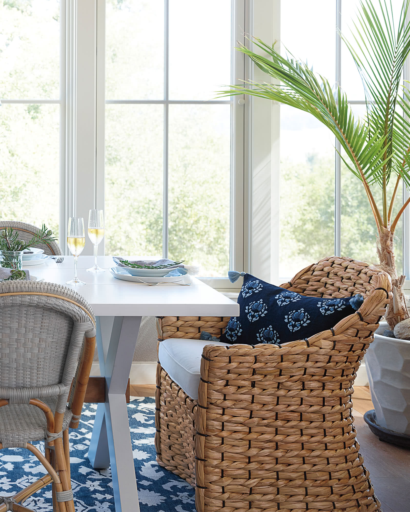 Islesboro Chair in a beautiful blue and white coastal style dining area.