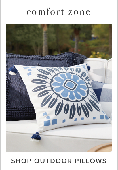 written text: Shop Outdoor Pillows