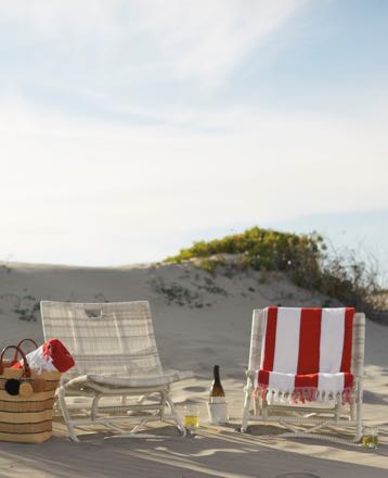 Outdoor beach chairs and towels